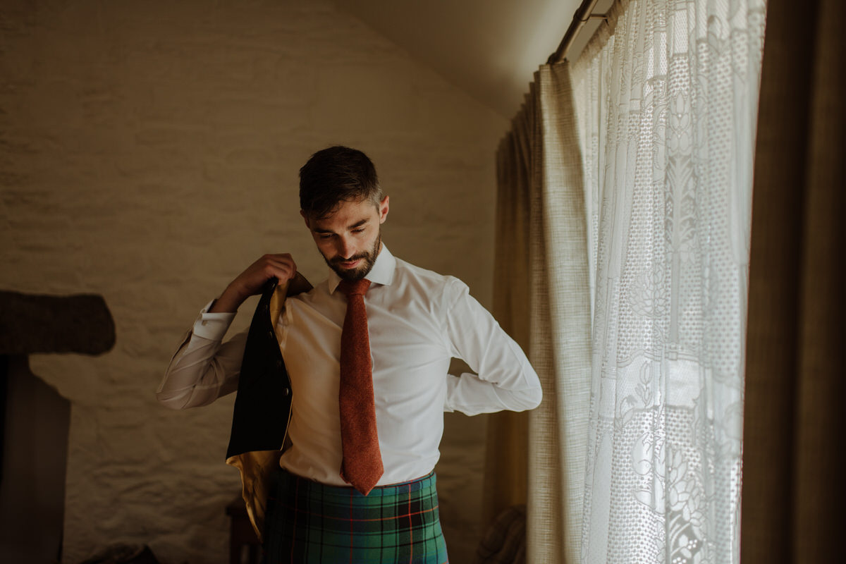 Groom getting ready in the cottage at Crear Weddings