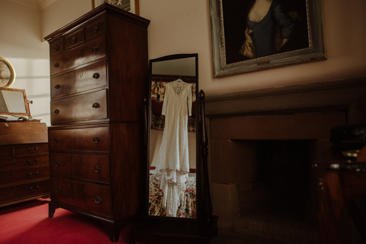 Brides dress hanging in Fingask Castle Wedding