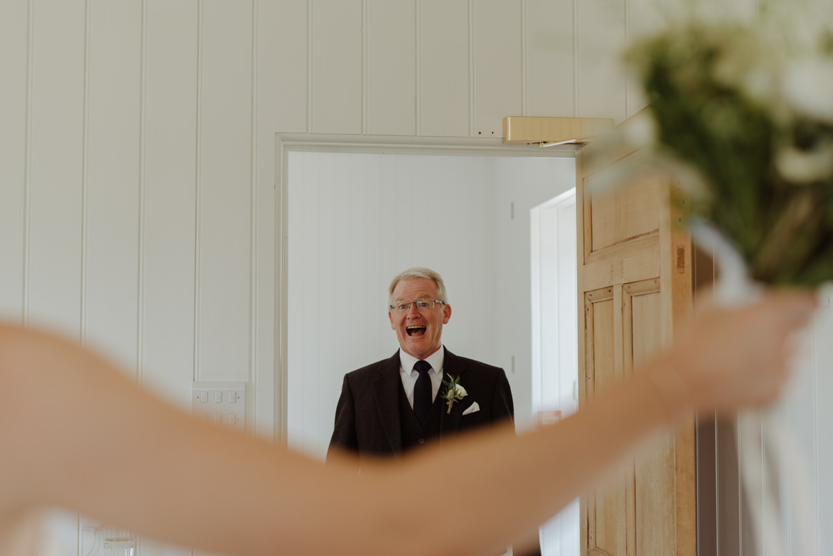 Father of the bride reacts to seeing the bride in her dress