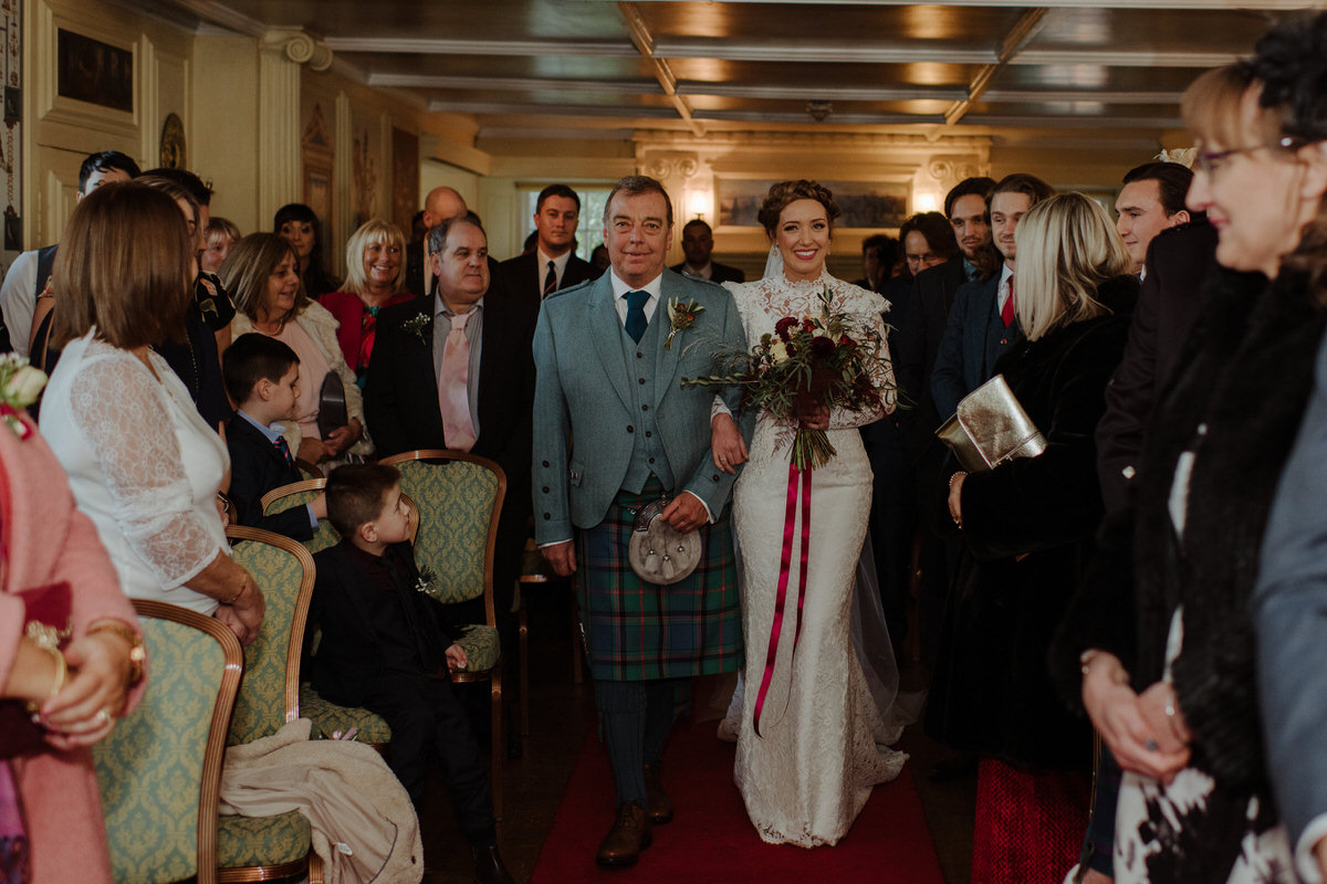 Bride walking down the aisle at Fingask Castle Wedding