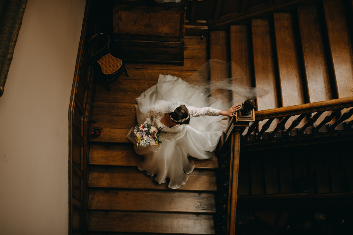 Bride going down the staircase at Cambo Estate