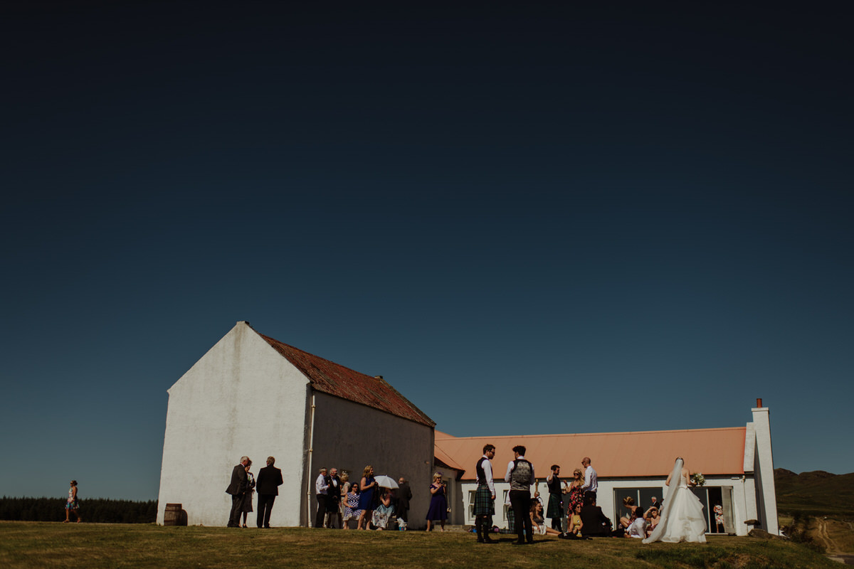 Guests hanging out in the sun at a Crear Wedding