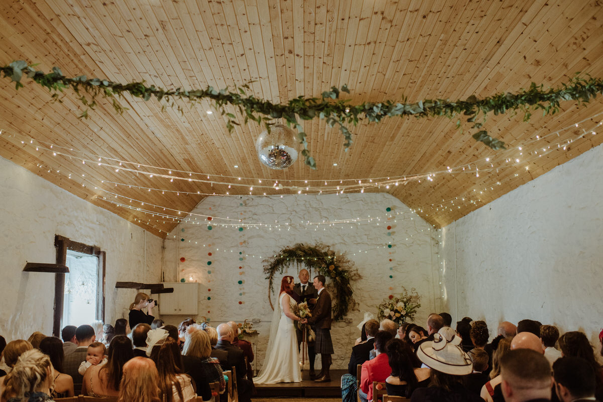 A wedding ceremony at a Dalduff Farm Wedding