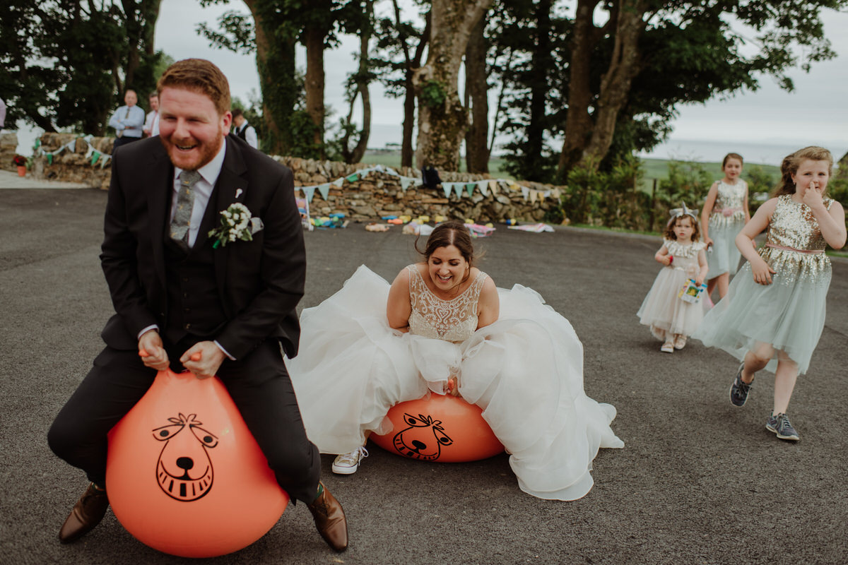 bride and groom space hopper race