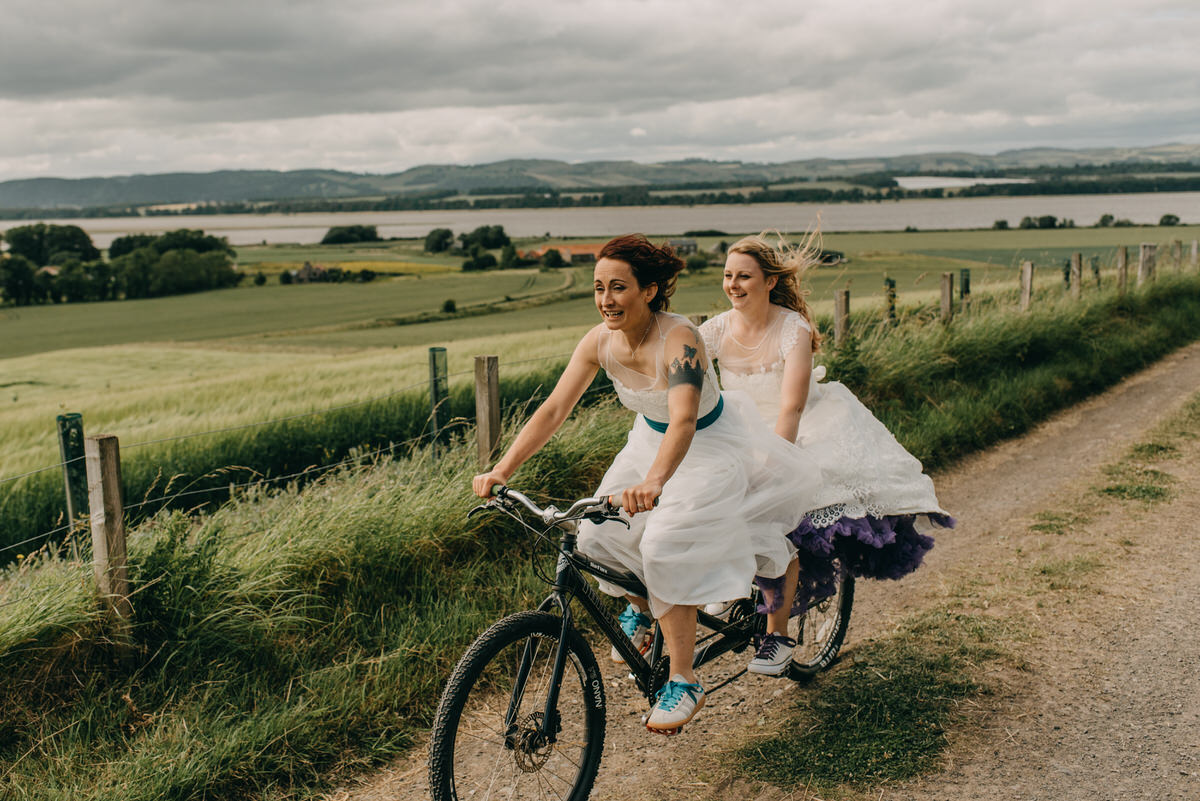Wedding couple on tandem bike in Scotland