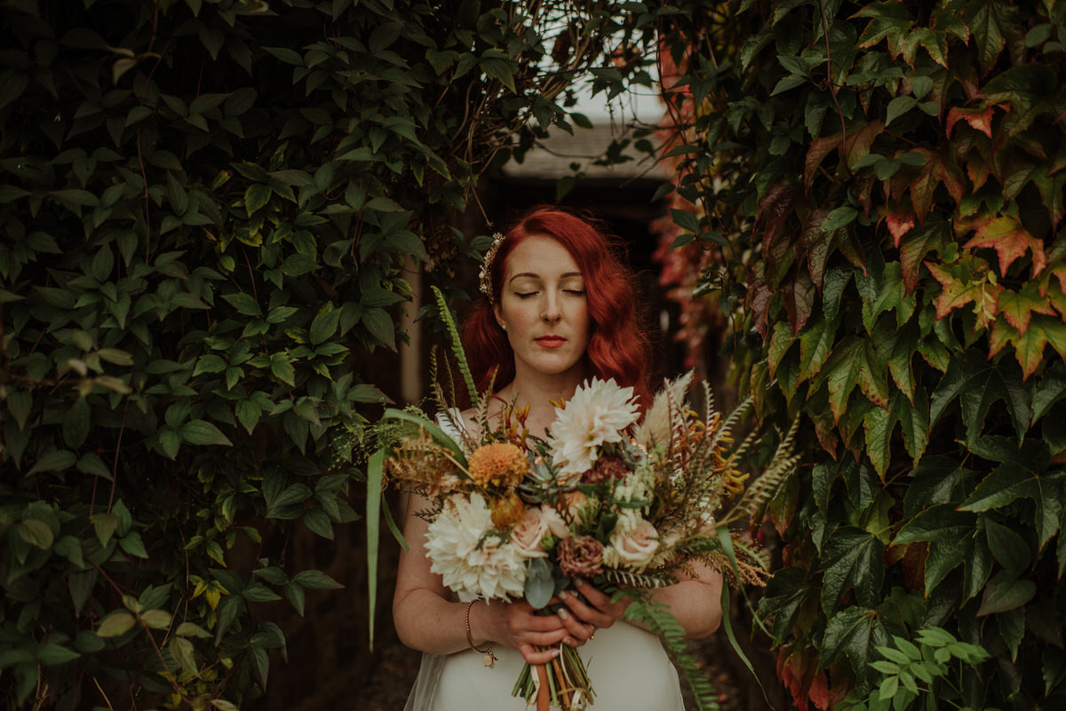 Bride with striking red hair at a Dalduff Farm Wedding