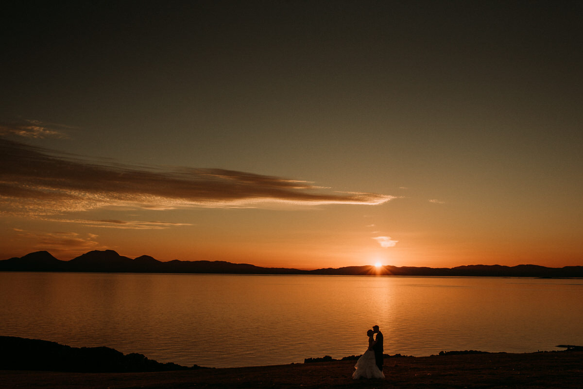 Bride and groom enjoying the Crear sunset over Jura