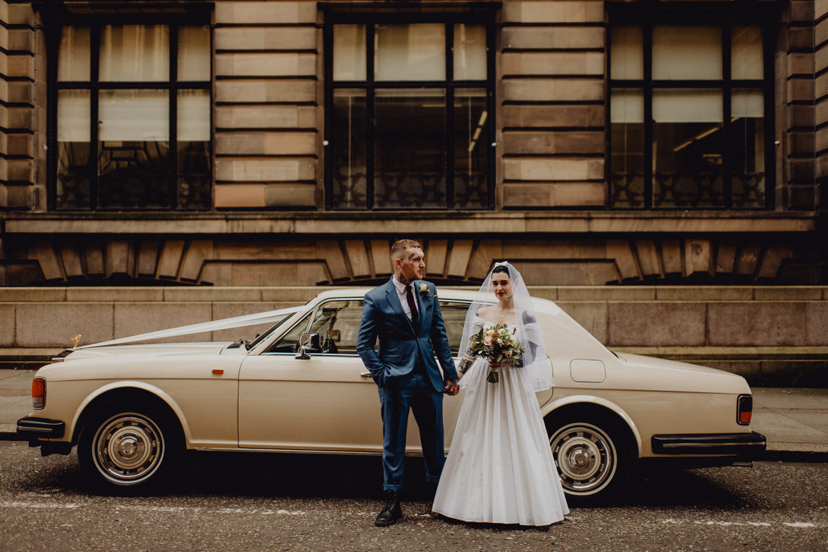 A wedding pose next to a rolls royce in Glasgow
