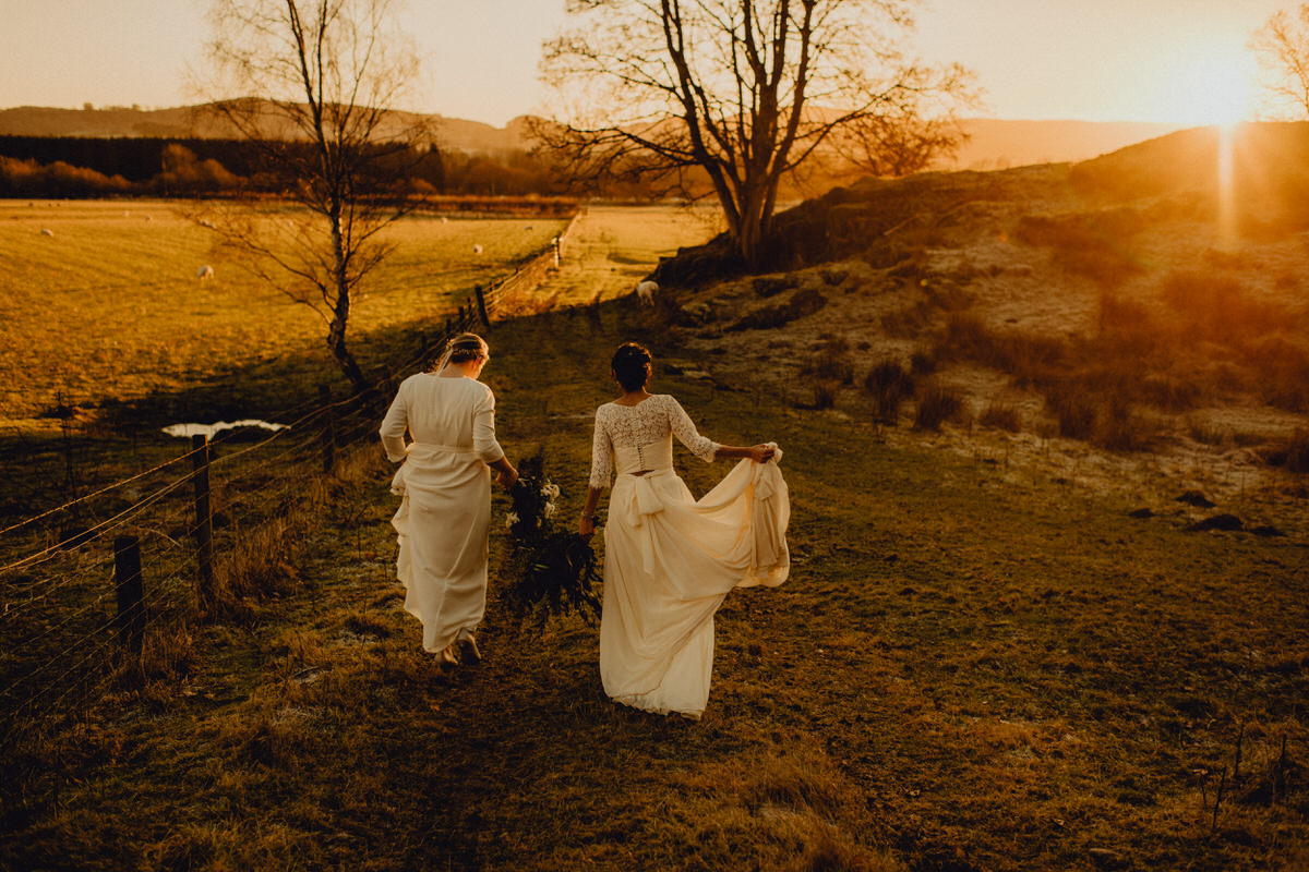 A wedding couple go a walk at sunset