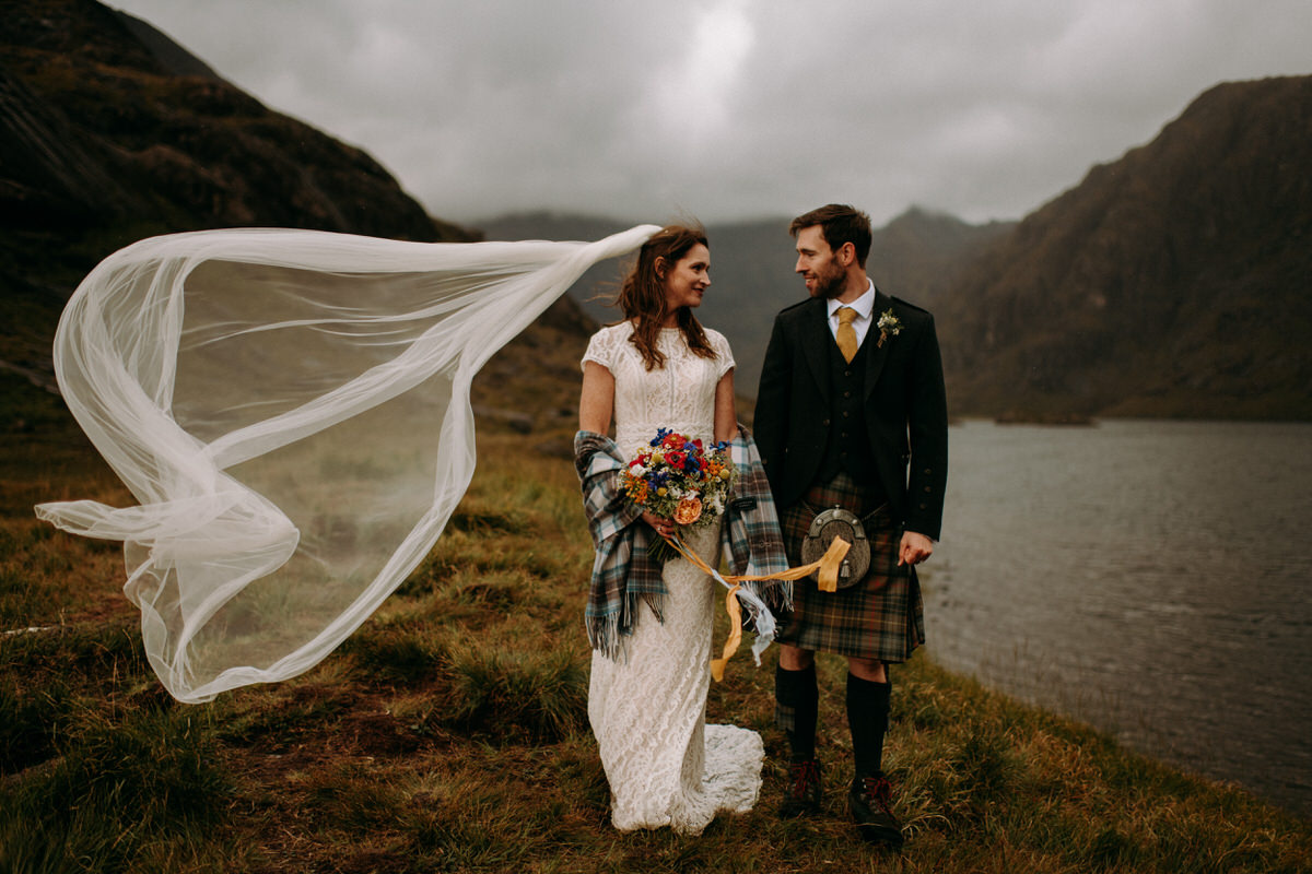 A wedding couple pose at loch coruisk on the Isle of Skye