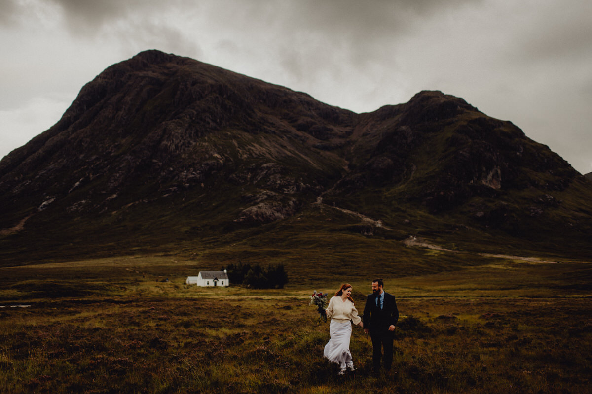 a wedding couple explore glencoe in scotland