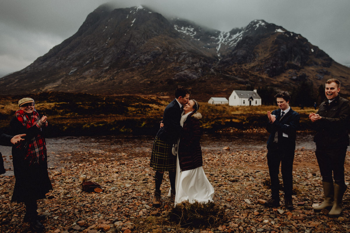 a couple have their wedding ceremony at etive mor in glencoe scotland
