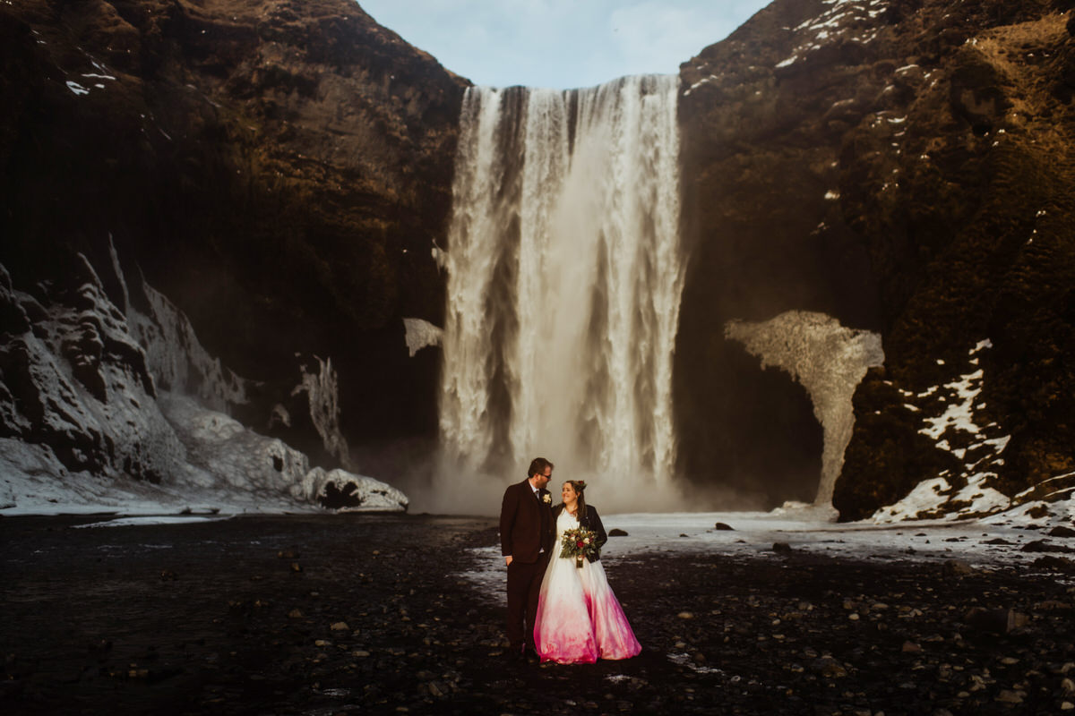 a wedding couple at Skógafoss in Iceland