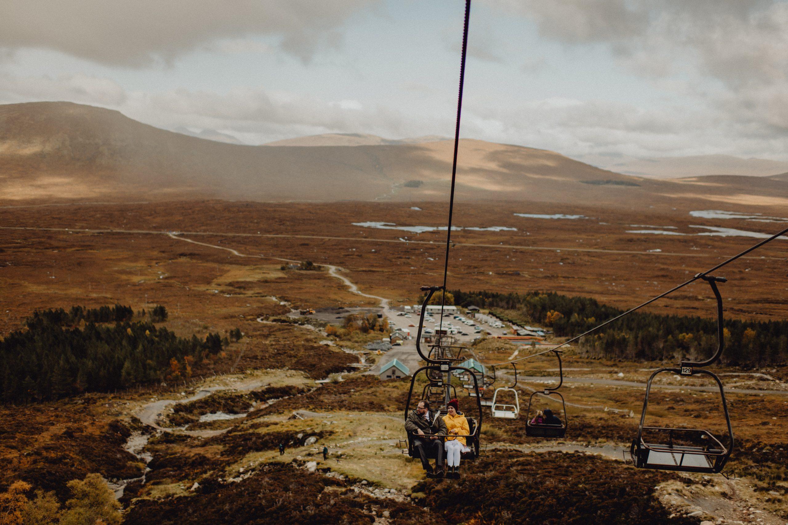 A wedding couple go up a ski lift at Glencoe in Scotland